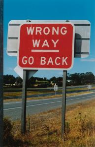 Wrong Way sign on the highway of life